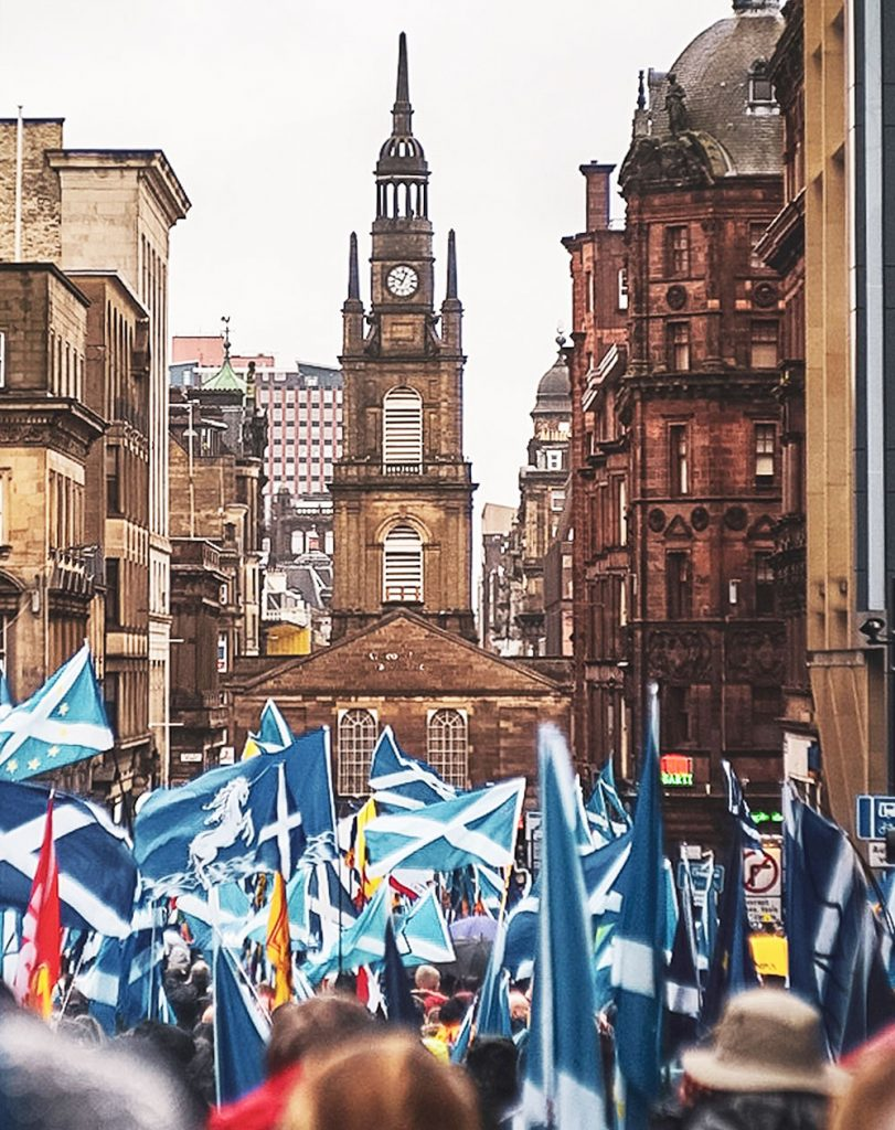 Scottish Independence march with saltire flags