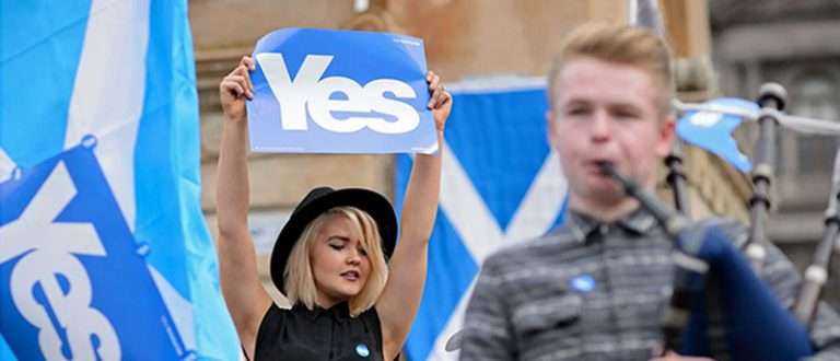Girl Holding Yes Poster
